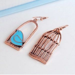 Copper colored asymmetrical birdcage earrings NEW
